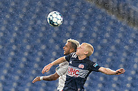 FOXBOROUGH, MA - SEPTEMBER 1: Maxi Schenfeld #19 of FC Tucson and Connor Presley #7 of New England Revolution II battle for head ball during a game between FC Tucson and New England Revolution II at Gillette Stadium on September 1, 2021 in Foxborough, Massachusetts.