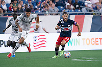 FOXBOROUGH, MA - JULY 25: Carles Gil #22 of New England Revolution during a game between CF Montreal and New England Revolution at Gillette Stadium on July 25, 2021 in Foxborough, Massachusetts.