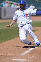 Iowa Cubs Javy Baez slides into home during the game against the New Orleans Zephyrs  at Principal Park on April 13, 2016 in Des Moines, Iowa.  The Cubs won 9-5 .  (Dennis Hubbard/Four Seam Images)