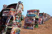 Graffitti covered Cadillacs at Cadillac Ranch along Route 66 east of Amarillo, Texas.