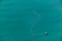 Aerial of Commercial Fishing gill netting Bow Picker with net soaking for Salmon in Port Wells, Prince William Sound, Alaska