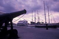 Bermuda, St. George's Parish, Cannon overlooking St. George's Harbor at sunrise in St George in Bermuda.
