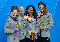 July 28, 2012: L to R: Missy Franklin, Jessica Hardy, Lia Neal, Allison Schmitt of United States of America pose with the bronze medal during award ceremony for women's 4x100m Freestyle Relay at the Aquatics Center on day one of 2012 Olympic Games in London, United Kingdom.
