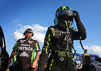 Aug. 16, 2013; Brainerd, MN, USA: NHRA funny car driver Alexis DeJoria with crew member during qualifying for the Lucas Oil Nationals at Brainerd International Raceway. Mandatory Credit: Mark J. Rebilas-