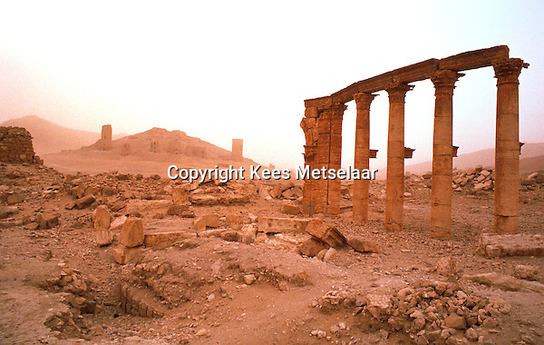 """Syria, Palmyra, Oct. 1989..Remains of this ancient city in south-central Syria, 130 miles (210 km) northeast of Damascus. The name Palmyra, meaning """"city of palm trees,"""" was conferred upon the city by its Roman rulers in the 1st century AD.<br /> Photo Kees Metselaar"""