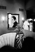 """Memphis, Tennessee<br /> USA<br /> August 14, 2002<br /> <br /> A bride passes through the lobby of the Heartbreak Hotel during """"Elvis Week"""" which marked the 25th Anniversary of the King's death."""