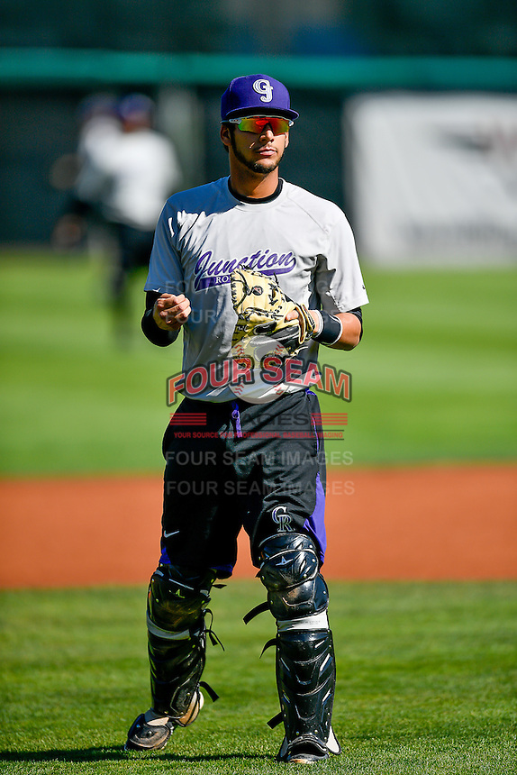 Joel Diaz (5) of the Grand Junction Rockies throws before the game against the Orem Owlz in Pioneer League action at Home of the Owlz on July 7, 2016 in Orem, Utah. The Owlz defeated the Rockies 15-3. (Stephen Smith/Four Seam Images)