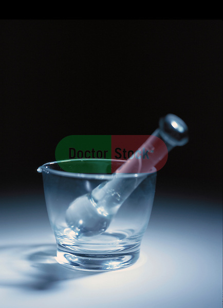still-life of clear glass mortar and pestle, icon of pharmacy