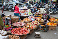 Myanmar, Burma.  Mandalay Street Scene.  Vegetables and fruits for sale in the market.