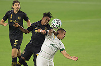LOS ANGELES, CA - SEPTEMBER 13: Latif Blessing #7 of the Los Angeles Football Club and Marvin Loria #44 of Portland Timbers battle for a ball during a game between Portland Timbers and Los Angeles FC at Banc of California stadium on September 13, 2020 in Los Angeles, California.