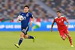 Doan Ritsu of Japan (L) is followed by Mataz Saleh Raboh of Oman during the AFC Asian Cup UAE 2019 Group F match between Oman (OMA) and Japan (JPN) at Zayed Sports City Stadium on 13 January 2019 in Abu Dhabi, United Arab Emirates. Photo by Marcio Rodrigo Machado / Power Sport Images