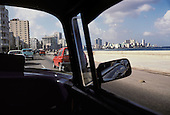 A taxi drives along the Malecon, the Havana sea-front