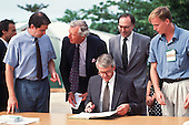 United Nations Conference on Environment and Development, Rio de Janeiro, Brazil, 3rd to 14th June 1992. Global Forum; Jonathon Porritt, Overseas Development Administration representative Gordon Armstrong, John Major, Environment Secretary Michael Howard; John Major writing his pledge.