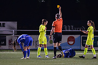Bodil Van Den Heuvel (22) of AA Gent gets a yellow card from referee Marnic Claes pictured during a female soccer game between  Racing Genk Ladies and AA Gent Ladies ,  on the 6 th  matchday of the 2021-2022 season of the Belgian Scooore Womens Super League , friday 8 october 2021  in Genk , Belgium . PHOTO SPORTPIX | JILL DELSAUX