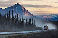 Truck on the James Dalton Highway, mount Dillon in the distance, Brooks Range, Arctic, Alaska.
