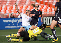 Erin McLeod #18 of Washington Freedom makes a save in front of Lindsay Tarpley #5 of Chicago Red Stars during a WPS match at RFK Stadium on June 13 2009, in Washington D.C.