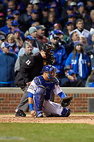Umpire Tony Randazzo and Chicago Cubs catcher Willson Contreras (40) in the ninth inning during Game 5 of the Major League Baseball World Series against the Cleveland Indians on October 30, 2016 at Wrigley Field in Chicago, Illinois.  (Mike Janes/Four Seam Images)