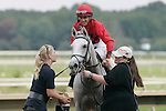 03 October 2009 CAPTION: Trainer Josie Carroll, left, offers water to  Careless Jewel (Robert Landry up) after the filly's victory in the Grade II Fitz Dixon Cotillion Stakes at Philadelphia Park Race Track.
