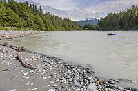 Packrafter crosses Fairweather creek at the Gulf of Alaska, Pacific ocean coast, Glacier Bay National Park, Southeast, Alaska