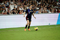 ORLANDO, FL - MARCH 05: Kelly O'Hara #5 of the United States looks for an open man downfield during a game between England and USWNT at Exploria Stadium on March 05, 2020 in Orlando, Florida.