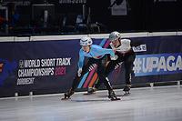 SPEEDSKATING: DORDRECHT: 06-03-2021, ISU World Short Track Speedskating Championships, RF 500m Men, Rino Vanhooren (BEL), Roberts Kruzbergs (LAT), ©photo Martin de Jong