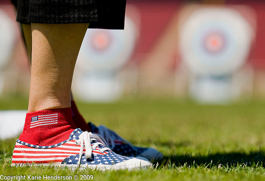 Lori Buenger of AK, sports her patriot shoes.  Lori plays in the women's 70-74 age bracket and started shooting a bow a year and half ago and decided to dedicate these games in memory of her nephew Chub Capello who passed away. At the Senior Games 2009,  in Palo Alto, Calif., at Stanford Standium, on Wednesday, August 05, 2009.