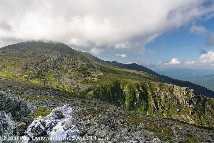 Mount Washington from Davis Path in Sargent's Purchase in the New Hampshire White Mountains on a cloudy summer day; this area is part of the Presidential Range. Tuckerman Ravine, named for Professor Edward Tuckerman, a botanist and early explorer of the White Mountains, is on the right.