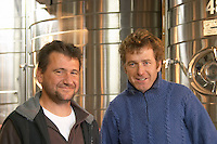 Guy Baldo, regisseur and chef at Chateau Laville Bertrou, left, and Ghislain Coux, regisseur at Domaine Hospitalet Domaine Gerard Bertrand, Chateau l'Hospitalet. La Clape. Languedoc. Stainless steel fermentation and storage tanks. France. Europe.