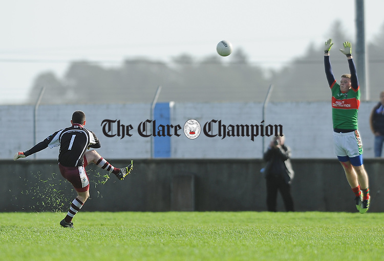 Killian Normoyle of Lissycasey scores a point from a free against  Kilmurry Ibrickane during their Minor Division One county football final at Cooraclare. Photograph by John Kelly.