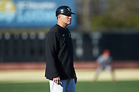 Wake Forest Demon Deacons head coach Tom Walter (16) coaches third base during the game against the Louisville Cardinals at David F. Couch Ballpark on March 7, 2020 in  Winston-Salem, North Carolina. The Demon Deacons defeated the Cardinals 3-2. (Brian Westerholt/Four Seam Images)
