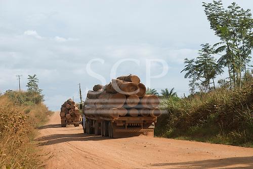 Xingu, Mato Grosso State, Brazil. Logging trucks on the MT322 (BR080) road.