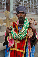 ETHIOPIA, Addis Ababa, orthodox priest with metal and wooden cross / Priester der orthodoxen Kirche mit Kreuz