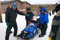 Shageluk residents Rodger & Arnold Hamilton check in Jason Barron's team on Friday afternoon
