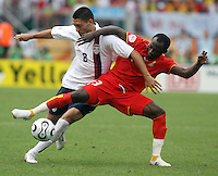 United States' Clint Dempsey (8) battles with Ghana's Haminu Draman (23). Ghana defeated the USA 2-1 in their FIFA World Cup Group E match at Franken-Stadion, Nuremberg, Germany, June 22, 2006. Ghana advances to round of 16 and the USA is out of the tournament.