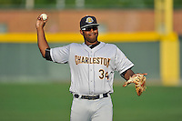 First baseman Chris Gittens (34) of the Charleston RiverDogs warms up before a game against the Greenville Drive on Tuesday May 17, 2016, at Fluor Field at the West End in Greenville, South Carolina. Greenville won, 4-2. (Tom Priddy/Four Seam Images)