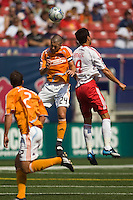 Houston Dynamo defender Wade Barrett (24) and New York Red Bulls forward Juan Pablo Angel (9) go up for a header. The New York Red Bulls defeated the Houston Dynamo 3-0 during a Major League Soccer match at Giants Stadium in East Rutherford, NJ, on August 24, 2008.