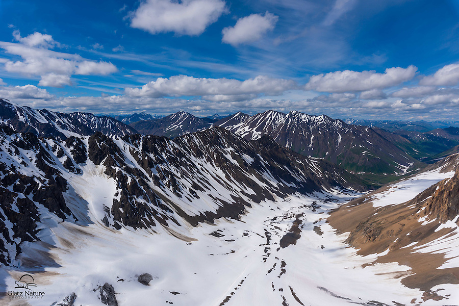 We were fortunate to get awesome weather and dramatic clouds when we went up in a helicopter over the Tordrillo Mountains, part of the Alaska Range, to photograph glaciers and other scenery, including a summer dog sled camp.  Matanuska Susitna, Alaska.