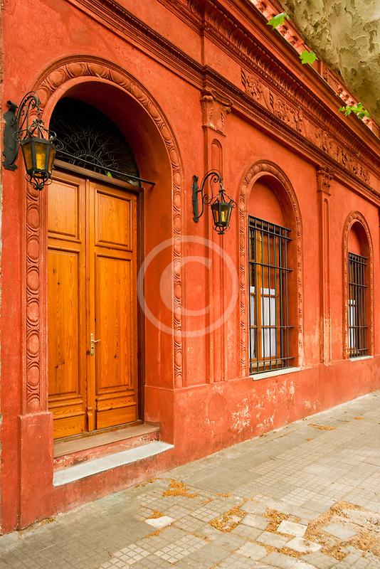 Uruguay, Colonia de Sacramento, Arched doorway along cobbled side street