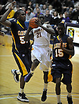 13 December 2008: Albany's Mike Johnson drives for the basket in a game between Canisius and Albany won by Albany 74-46 at SEFCU Arena in Albany, New York.