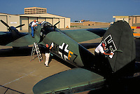 Volunteers clean up a WWII German Heinkel bomber at the Cavanaugh Flight Museum in Dallas, Texas. Historic aircraft of all eras are on display and flown at the museum. Aviation, military,. Dallas TX USA.