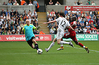 Pictured: Sam Evans of Team Woodyatt (C) goas for goal against goalkeeper Terry Alderton (L), challenged by Adrian Forbes (R). Sunday, 01 June 2014<br /> Re: Celebrities v Celebrities football game organised by Sellebrity Scoccer, in aid of Swansea City Community Trust, at the Liberty Stadium, south Wales.
