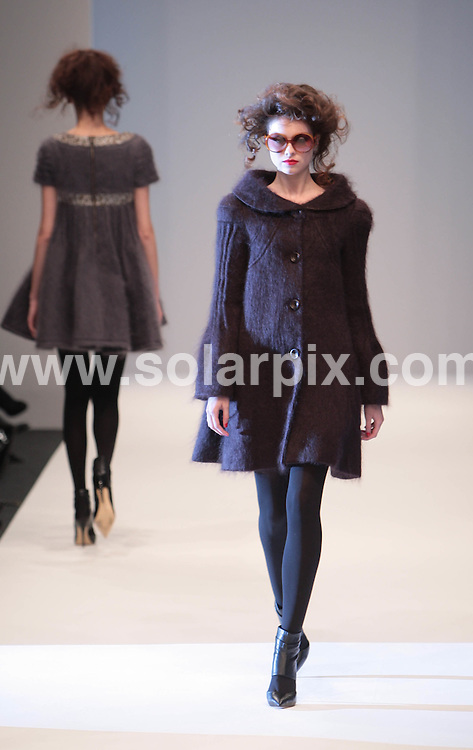 **ALL ROUND PICTURES FROM SOLARPIX.COM**.**NO UK NEWSPAPER PUBLICATION**.**UK MAGAZINE & SUPPLEMENT PUBLICATION ONLY** AND NO PUBLICATION IN AUSTRALIA, FRANCE, GERMANY, ITALY AND SCANDINAVIA** .The Paul Costelloe catwalk show at London Fashion Week, London, UK. 20 February 2009..This pic: Paul Costelloe catwalk show..JOB REF: 8508 SFE       DATE: 20_02_2009.**MUST CREDIT SOLARPIX.COM OR DOUBLE FEE WILL BE CHARGED**.**ONLINE USAGE FEE  GBP 50.00 PER PICTURE - NOTIFICATION OF USAGE TO PHOTO @ SOLARPIX.COM**
