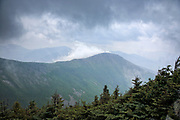 Storm clouds engulf Bondcliff from the summit of West Bond in the Pemigewasset Wilderness of the New Hampshire White Mountains during the summer months.
