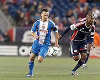 Philadelphia Union forward Jack McInerney (9) on the attack. In a Major League Soccer (MLS) match, the New England Revolution (blue/red) defeated Philadelphia Union (blue/white), 2-0, at Gillette Stadium on April 27, 2013.