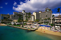 Aerial view of Halekulani Hotel, surrounding establishments, and the beachfront in Waikiki