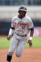 Fort Myers Miracle outfielder Adam Brett Walker II (12) runs the bases during a game against the Charlotte Stone Crabs on April 16, 2014 at Charlotte Sports Park in Port Charlotte, Florida.  Fort Myers defeated Charlotte 6-5.  (Mike Janes/Four Seam Images)