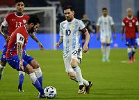 3rd June 2021; Estadio Único de Santiago del Estero, Santiago del Estero, Argentina; World Cup football qualification, Argentina versus Chile; Lionel Messi of Argentina is tackled by Eugenio Mena of Chile