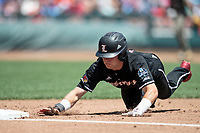 Louisville Cardinals outfielder Jake Snider (20) dives back to first base during Game 3 of the NCAA College World Series against the Vanderbilt Commodores on June 16, 2019 at TD Ameritrade Park in Omaha, Nebraska. Vanderbilt defeated Louisville 3-1. (Andrew Woolley/Four Seam Images)