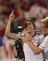 USA forward Herculez Gomez (30) celebrates his goal with USA midfielder Stuart Holden (22). In the Send Off Series, the Czech Republic defeated the US men's national team, 4-2, at Rentschler Field in East Hartford, Connecticut, on May 25, 2010.