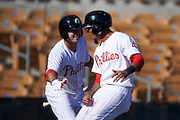 Glendale Desert Dogs shortstop J.P. Crawford (4) is congratulated by Andrew Knapp (8) after scoring the game winning run during an Arizona Fall League game against the Mesa Solar Sox on October 13, 2015 at Camelback Ranch in Glendale, Arizona.  Glendale defeated Mesa 8-7.  (Mike Janes/Four Seam Images)